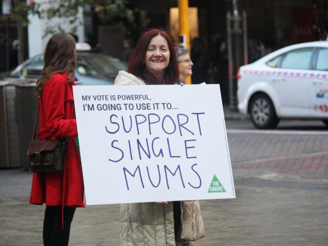 Rachel Siewert with a supporting single mums sign
